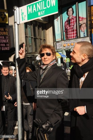 Singer Barry Manilow (L) and Producer and Jujamcyn Theaters President, Jordan Roth attend the Manilow Way Street Sign Unveiling in Times Square on January 22, 2013 in New York City.