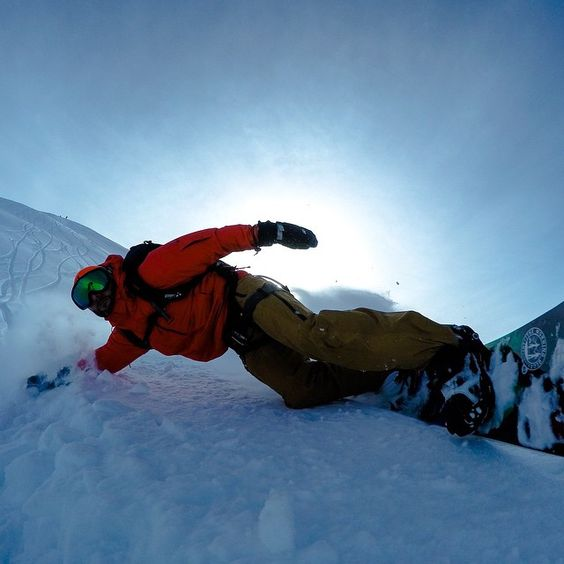 GoPro Featured Photographer - @clarkfyans  We used a HERO4 Black set to 30/3s burst mode to catch this snowboard hand-drag way up in the Tordrillo Mtns of Alaska! #GoPro #snowboarding #Alaska #handdrags