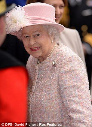 Tweed delight: The Queen looked thrilled to be paying a visit to Lloyd's of London today and wore her favourite style of hat, trademark pearls 3/27/14