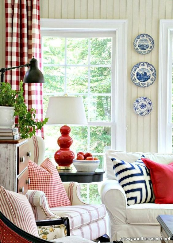 Classic style and traditional decor in a Southern sun room with red, white, blue, stars, stripes, checks, and charm. #traditional #sunroom #redwhiteblue #americana #patriotic #gingham #decoratingideas