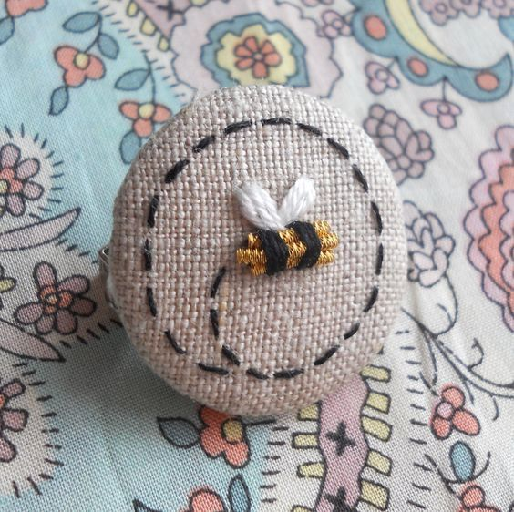 Made to Order Goldwork Bee Hand Embroidered Brooch Badge supporting the BBKA. £8,00, via Etsy.: