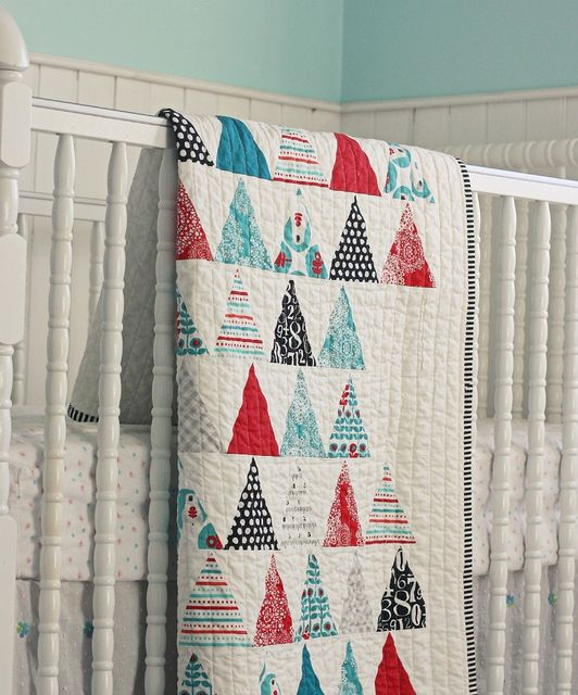 Would love to make one in these colors for winter....Brrr! Triangles Quilt by BlueElephantStitches, via Flickr: