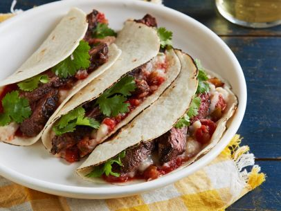Salsa-Marinated Skirt Steak Soft Tacos with Refried White Beans from the new #ChoppedCookbook