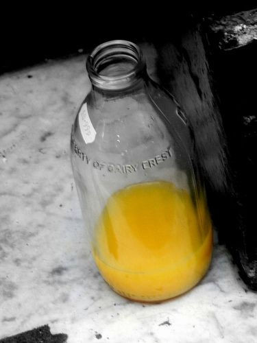 Orange juice in a glass bottle as it came from the milkman
