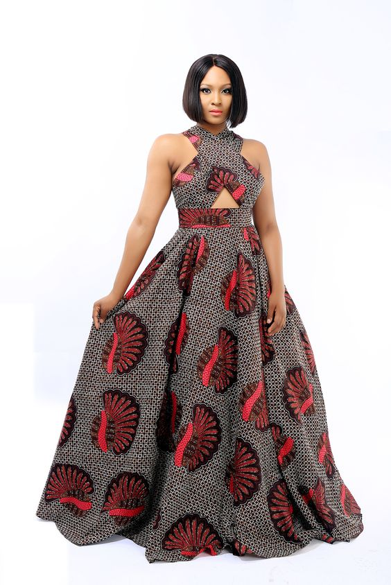 A gorgeous red and black tribal print gown with criss cross shoulders and an elegant full skirt. This dress is custom made to size, and has a 3 week lead time. 100% Cotton. Dry Clean only.