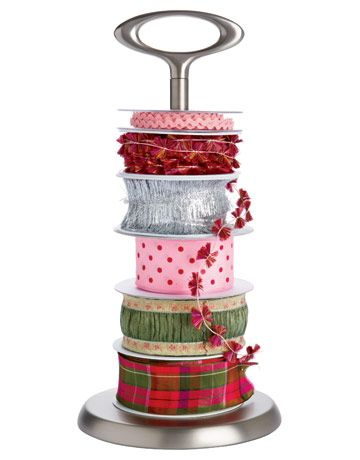 Paper towel holder to organize spools of ribbon...smart.