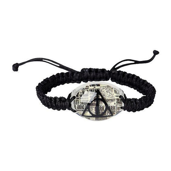 Harry Potter Deathly Hallows Cord Bracelet Hot Topic ($4.87) ❤ liked on Polyvore featuring jewelry, bracelets, black cord bracelet, black bangles, black jewelry, rope bracelet and charm bangle