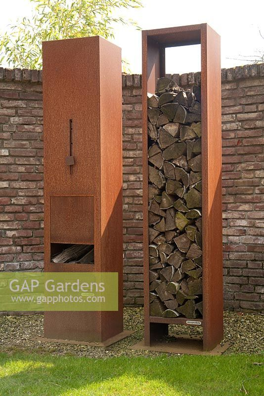 Rusted Metal Log Burning Patio Heater And Wood Storage Appeltern Garden Holland Plant Photography Patio Heater Landscape Design