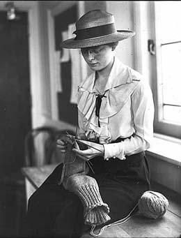 University of Washington student Geraldine Gilbert knitting two socks at once for soldiers, 1918