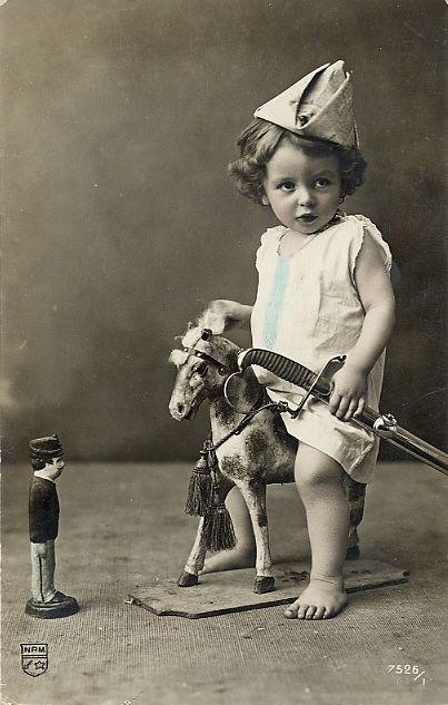 child on toy horse: