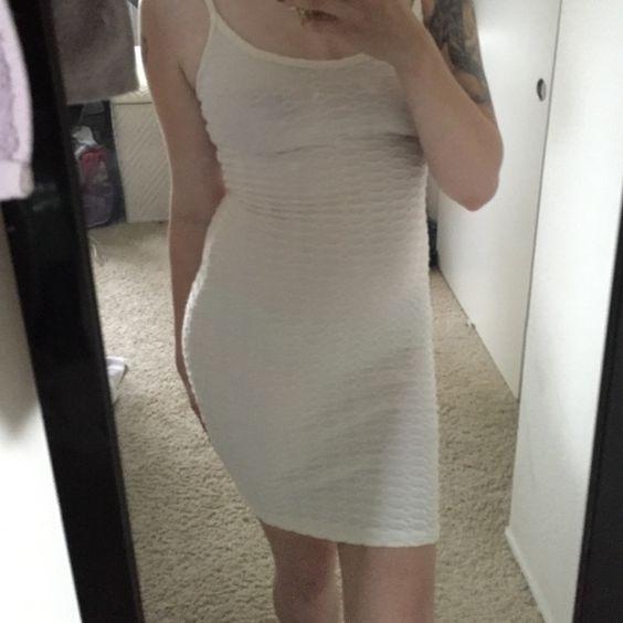 Calvin Klein white bodycon dress Never worn, bodycon dress by Calvin Klein. Can fit medium. Calvin Klein Dresses