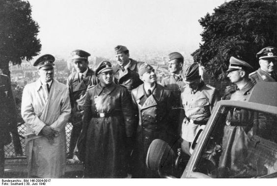 Adolf Hitler visits Paris for a few hours on June 30, 1940. His escort include Albert Speer (right behind Hitler) and Nazi party chief Martin Bormann (to Hitler's left). The SS officer at the far right of the photo, presenting profile to the camera, is Himmler's chief-of-staff and SS Liaison Officer with Hitler, Karl Wolff.