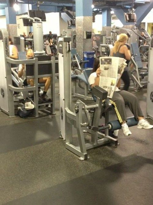 guy at gym reading newspaper