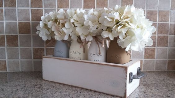 This painted milk jar centerpiece is so adorable and will be the perfect touch to set off your farmhouse decor!! Each jar has been painted, distressed and sealed. The jars are not dishwasher safe but can be cleaned with a damp cloth. The jar can hold fresh flowers and be rinsed out.  This set includes: One 3x 12 Wood Planter Box 4 Pint Painted Milk Jars Painted in the Colors of Your Choice {see pic 5 and leave me a note with you color choices in the notes to seller box at checkout} 4 Antique…