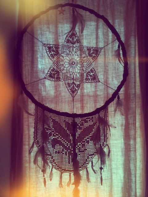 Very pretty dream catcher for window of your home. I love the way the light shines through on this one.