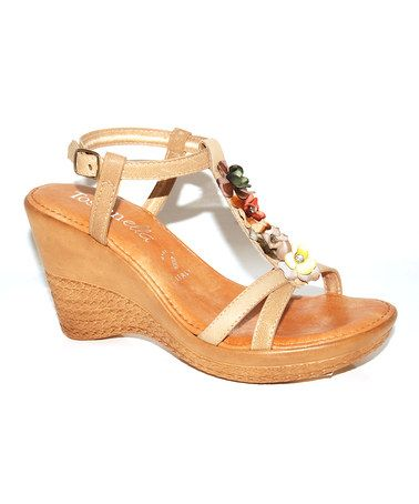 Take a look at this Natural Blossom Wedge Sandal by Toscanella on #zulily today!