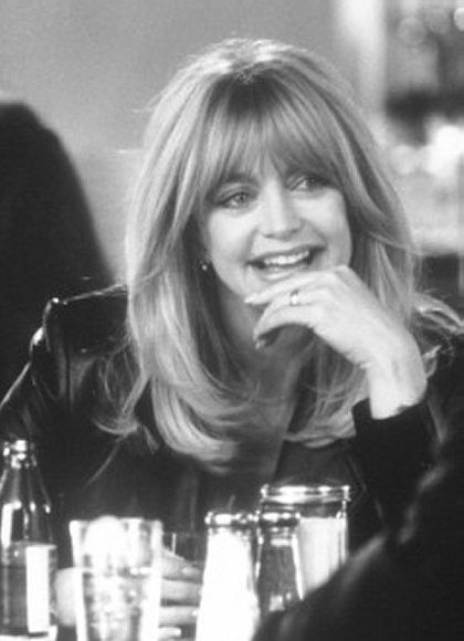 Goldie Hawn. Her full choppy fringe tapers from lash length to jawbone length and is usually center parted, flipped back from her face. Oval to round face shape, medium high forehead