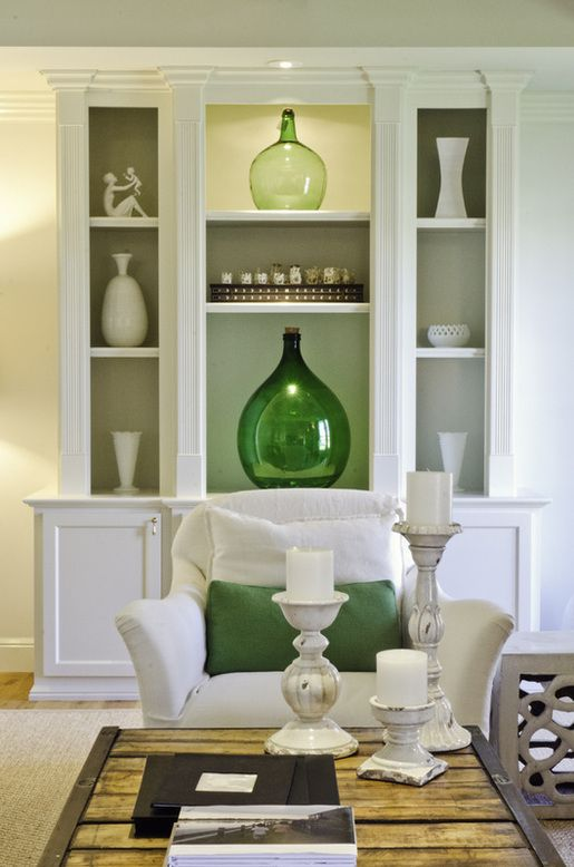 green bottles white living room built ins