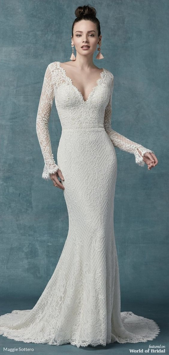 This sleeved boho wedding dress is comprised of allover lace, with sheer lace comprising the long sleeves, bell cuffs, V-back, and V-neckline. Sheath silhouette lined with York jersey for a luxe feel.