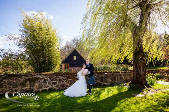 Wedding couple in the beautiful grounds at Gate Street Barn.