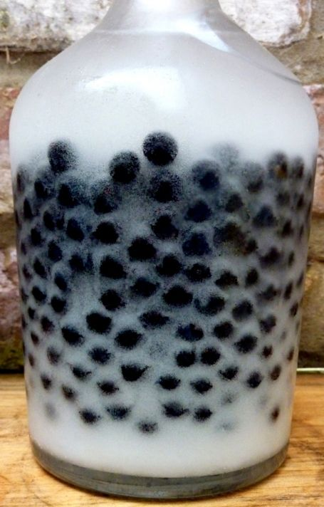 Sloe Gin - you can use any dark berry (blueberry, huckleberry, blackberry). Tastes like a jolly rancher.