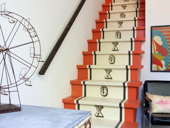 Give a plain white staircase a whole new personality by creating a faux runner. Paint the outer edges, add stripes and stamp Xs and Os on the risers for a new, whimsical look.