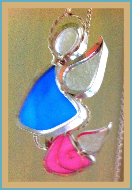 sweet winged creatures floating in a wind chime by SusanBetke, $25.00