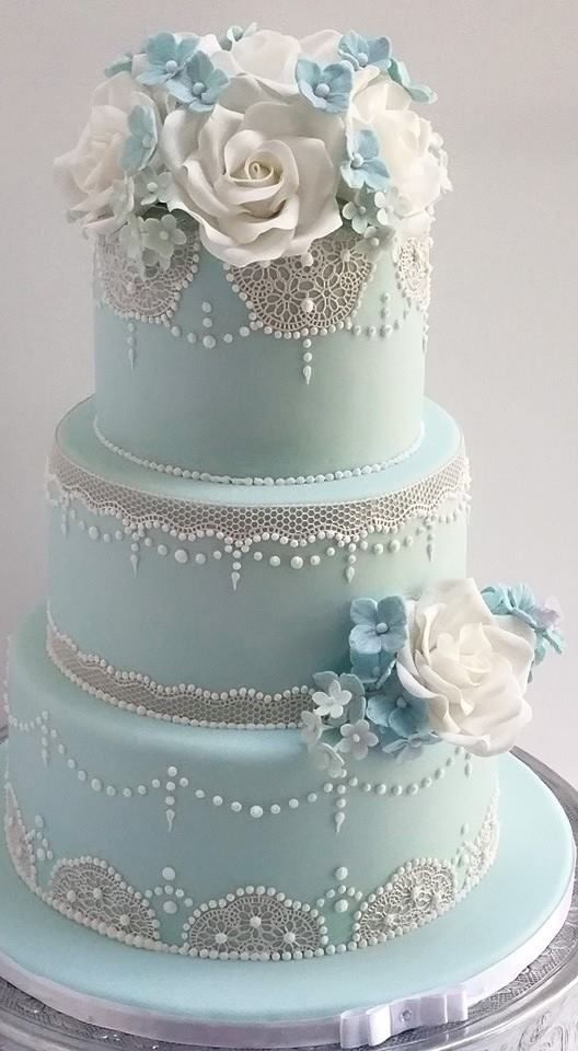 this lace style with maybe a different blue and not tiered  Pale blue Lace wedding cake
