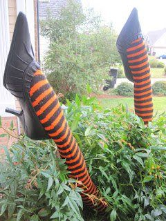 Put Halloween tights on pool noodles, then shoes,  perfect decoration!