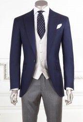 Dark Blue Half Morning Suit  JACKET: 1 button, peak lapel, 1 slit; Dark Blue Color  Fabric: 100% wool yarn, super 140, 250 gr  PANTS: Without pince; pocket American, primer 20; Gray  Fabric: 100% wool, yarn 120's, 250 gr  WAISTCOAST 4 Buttons, Pear color Fabric: 100% silk