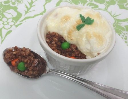 "APRIL FOOLS! Shepherd's pie?  YOU LIE!! That's right it's dessert - I created these out of Cocoa Krispie Treats mixed with ""carrot and peas"" made out of taffy.  Melt some marshmallows in a little butter, spread on top and broil for a few seconds.  My hubby was totally fooled by this one! :)"