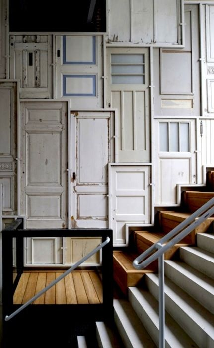 re-used doors, wall decor.....but I would use a couple not this many...less is more.