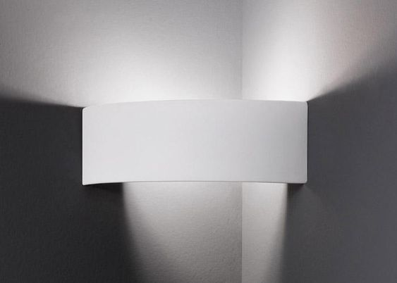 the kolarz arco corner wall light is a ceramic corner wall light that can be painted if required the arco corner ceramic wall uplighter is available from arco lighting