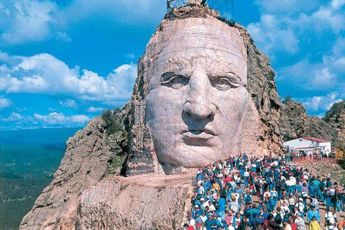 Create a lasting memory up on the arm of the Crazy Horse Monument in South Dakota -- go the first weekend in June and hike up onto it.
