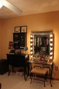 Tricia's Tips: Affix light bulb strips to a mirror to create a lighted vanity area. You will be amazed at how much money you save!