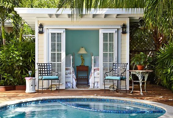 My future pool house... twin beds with a view of the pool - the perfect cabana!
