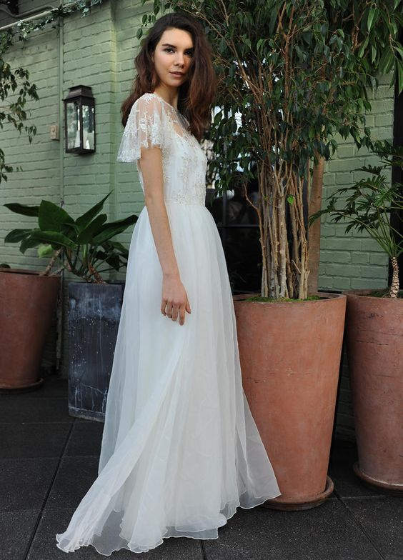 Sarah Seven organza wedding dress with detailed illusion neckline and flutter sleeves Fall 2016 | https://www.theknot.com/content/sarah-seven-wedding-dresses-bridal-fashion-week-fall-2016