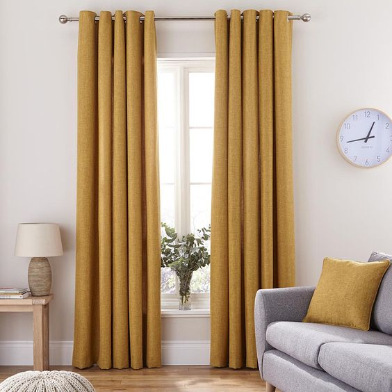 Featuring a woven textured effect, this pair of luxurious, fully lined Vermont curtains come in a contemporary and bold mustard yellow colour. Finished with a sleek eyelet header, these plain curtains are available in a selection of widths and drops.