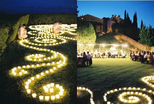 Votive candles on the lawn.