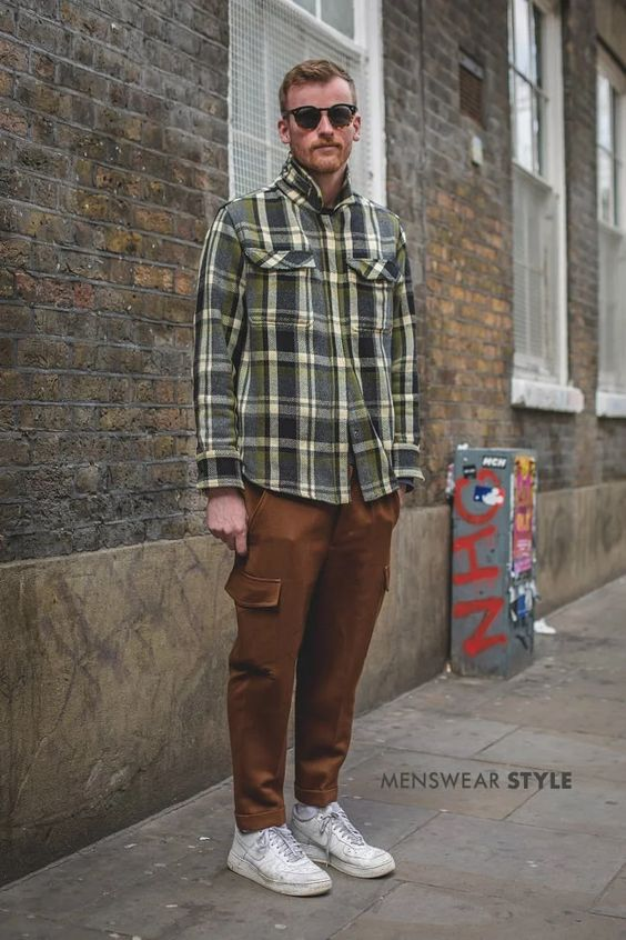 This is Greg on the streets of London in 2019 wearing White Nike Air, Brown Wool Cargo Trousers, Plaid Shirt Jacket, and Tortoise Shell Sunglasses.