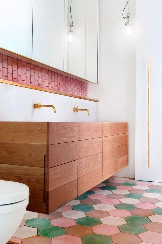 colorful floor tiles, wooden drawers, + pink subway tiles