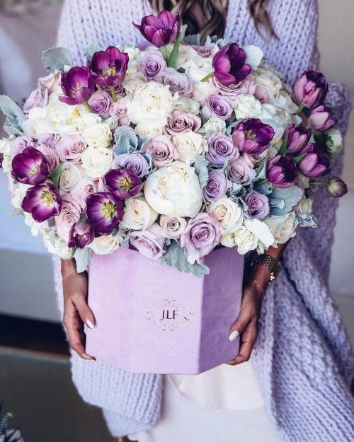 A Pretty Purple And White Floral Arrangement In A Hat Box Flower Arrangements Floral Arrangements Beautiful Flower Arrangements