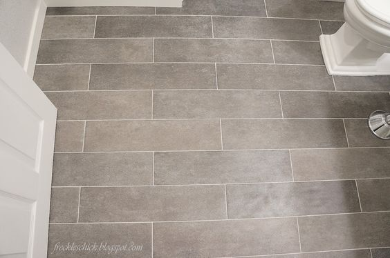 plank bathroom floor tile. LOVE IT!  All you have to do is CUT the full tiles into plank sized pieces, they lay down just like regular tile!