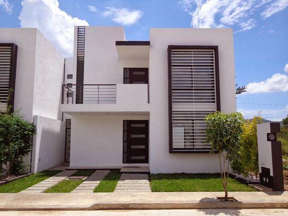 Hermosa residencia con fachada contempor nea que pertenece - Casas con chimeneas modernas ...