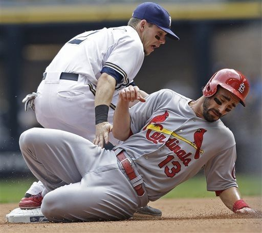 Matt Carpenter steals second base as Milwaukee Brewers' Scooter Gennett takes the late throw during the fourth inning...Cards won the game 8-6.  8-21-13