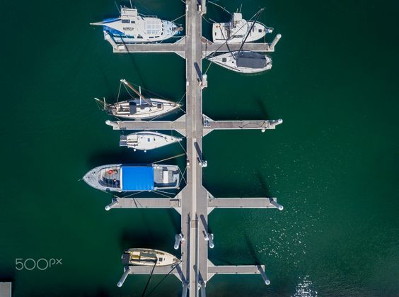 Aerial view of boats in the Hale'iwa boat harbor - Drone shot of boats in the harbor, north shore Oahu