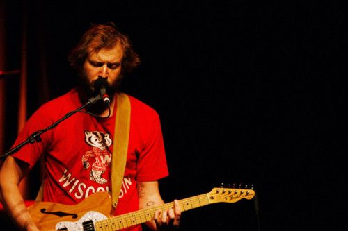 Justin Vernon of Bon Iver in a Wisconsin Badgers shirt.  It doesn't get much better.