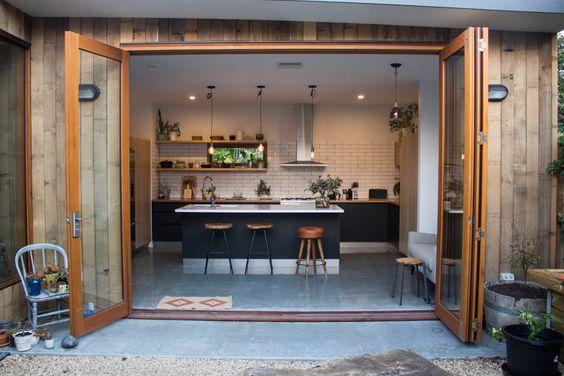 Black, white + timber kitchen, concrete floors