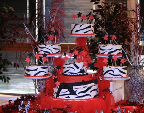 bright colors table decorations | Quinceanera wedding cake mix with red zebra motif with three pops at ...