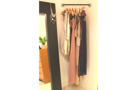 Put  a corner rod in your bedroom or closet and put this week's work clothes on it.